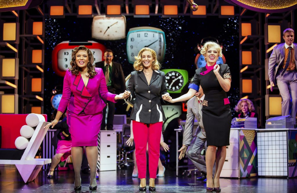 Louise Redknapp and co stars on stage for the 9 to 5 show.