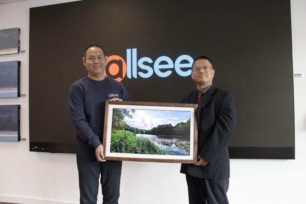Baoli Zhao and Yangang Xing with Allsee Photo Frame