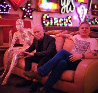 Photo of Erasure on a sofa to promote new tour